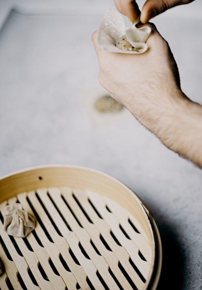 photo-of-person-making-dumplings-3296897